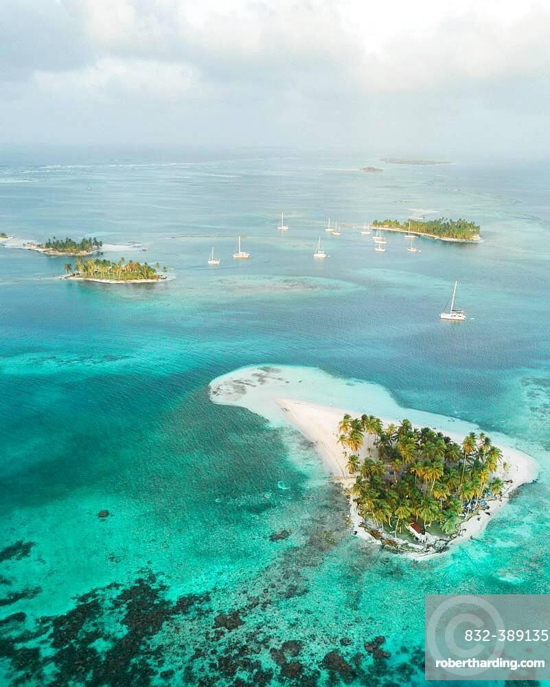 Aerial view, sailing boats between several small tropical palm islands, San Blas Islands