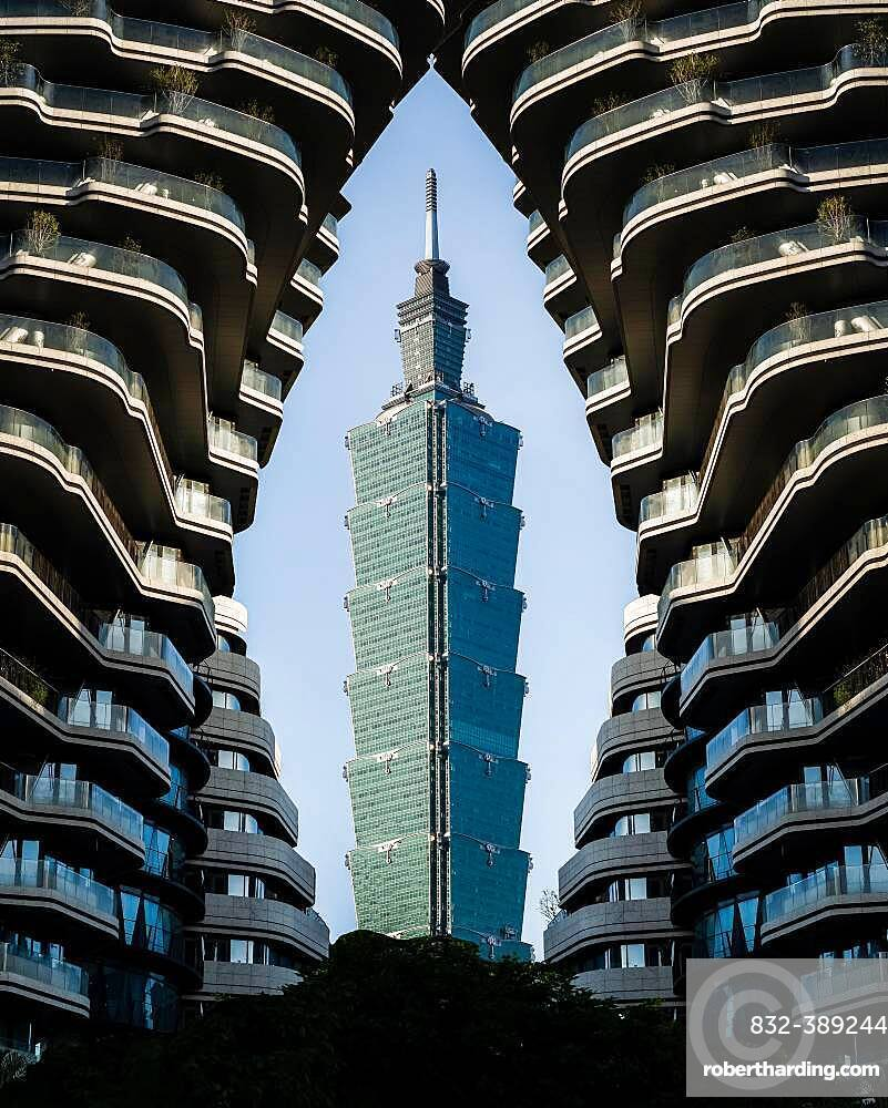 View of Taipei 101 Tower, framed by a high-rise building, Taipei, Taiwan, Asia