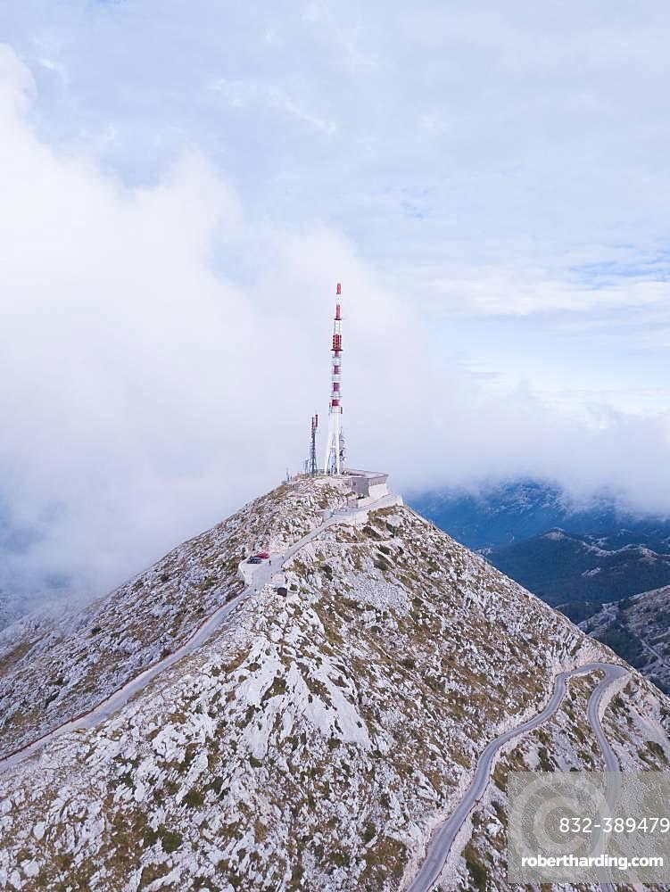 Aerial view, Sveti Jure mountain top with antenna surrounded by fog, Biokovo nature park Park, Croatia, Europe