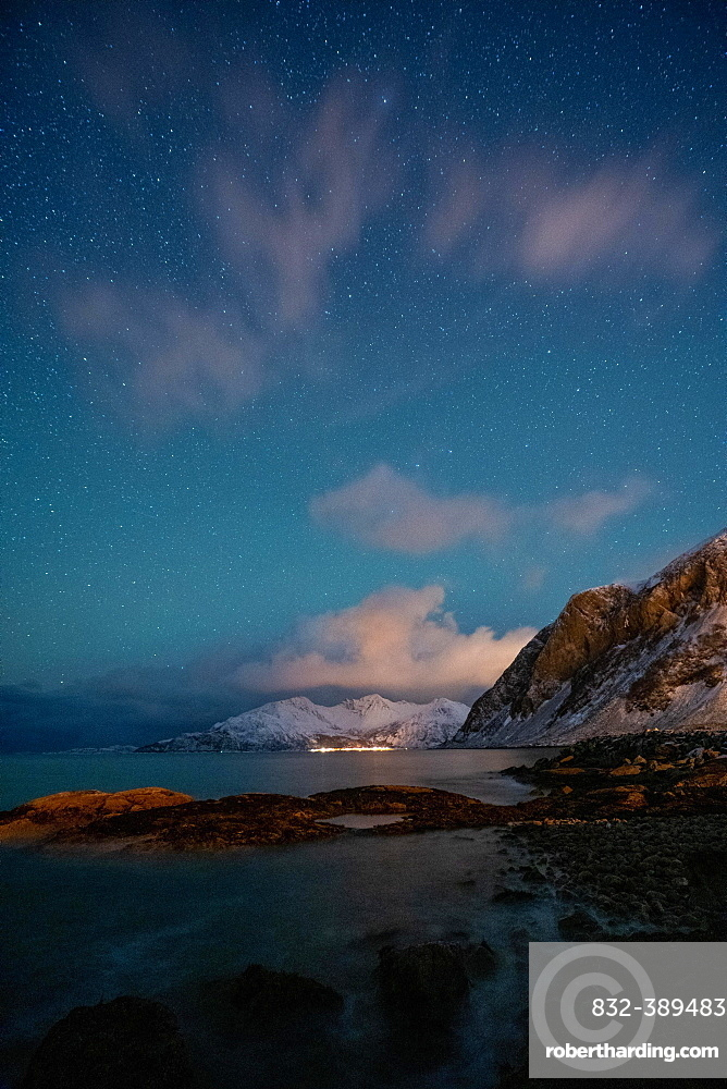 Northern lights over a Norwegian fjord, Tromso, Norway, Europe