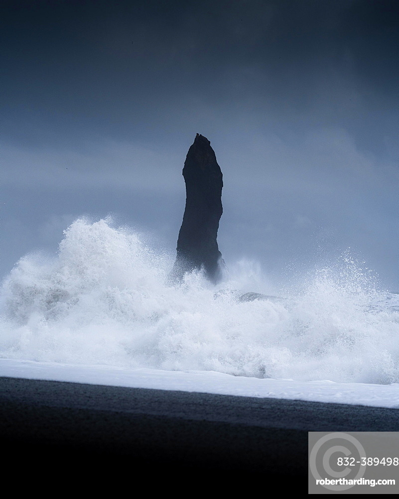 Sharp rock with strongly breaking waves on a volcanic beach, Vik, Iceland, Europe