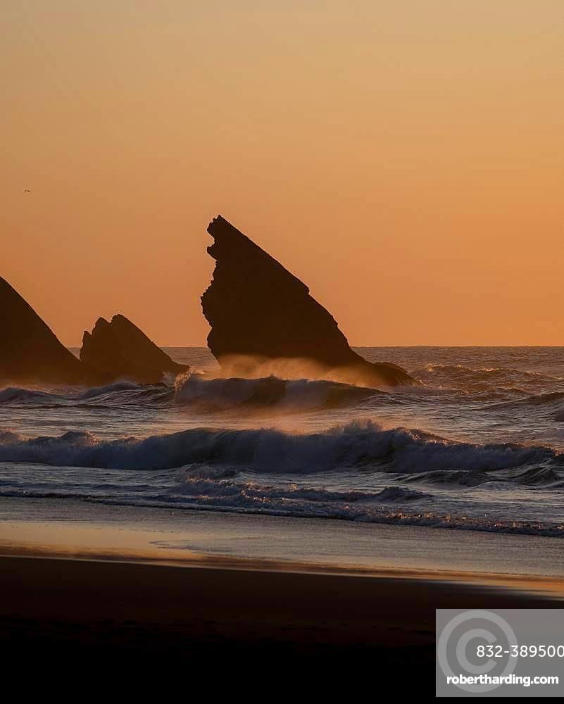 Sunset at Praia da Adraga with rock, Almocageme, Portugal, Europe