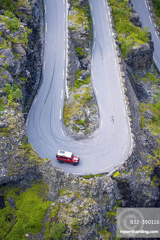 Single car, hairpin bend at the mountain road Trollstigen, near Andalsnes, More og Romsdal, Vestland, Norway, Europe