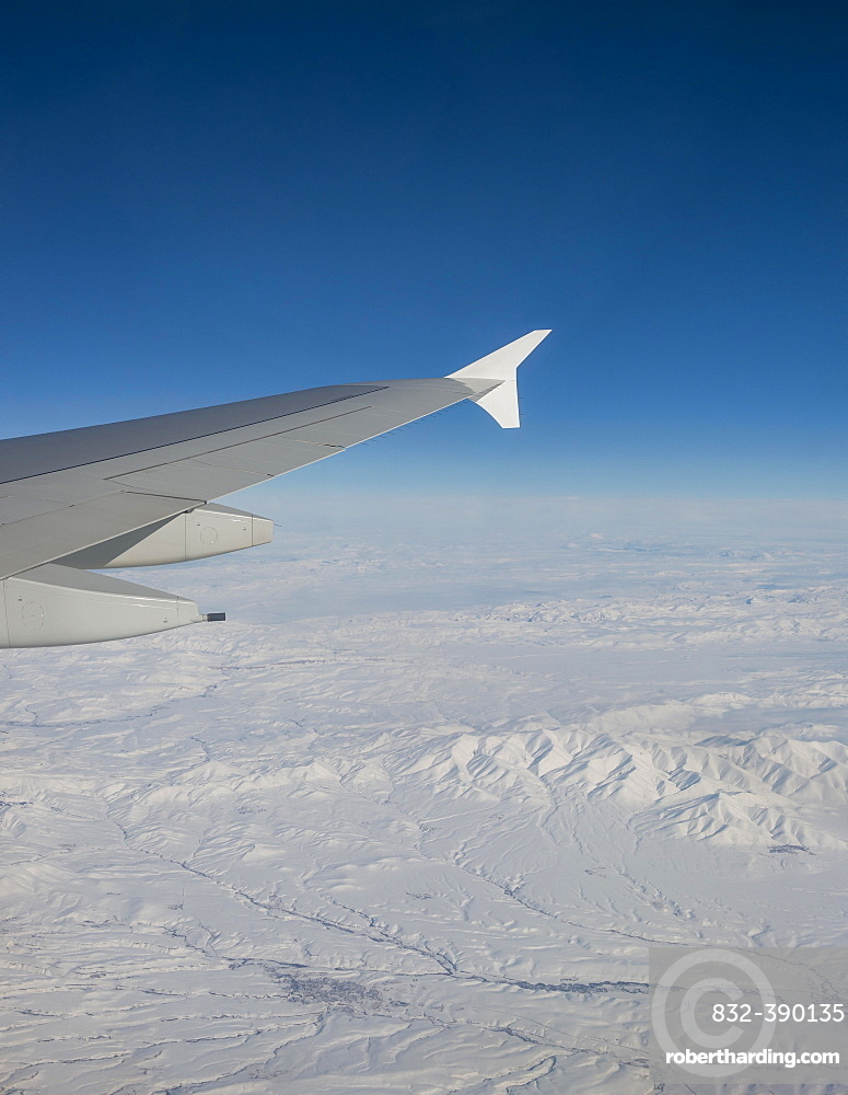 View of mountains and snowy landscape from the airplane, airplane wing of an Airbus A380, aerial view, Anatolia, Northeastern Turkey, Turkey, Asia