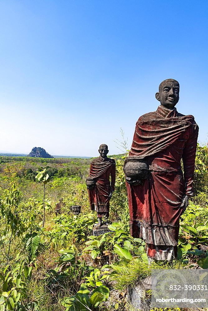Huge line of monk statues in Win Sein Taw Ya outside Mawlamyine, Mon state, Myanmar, Asia