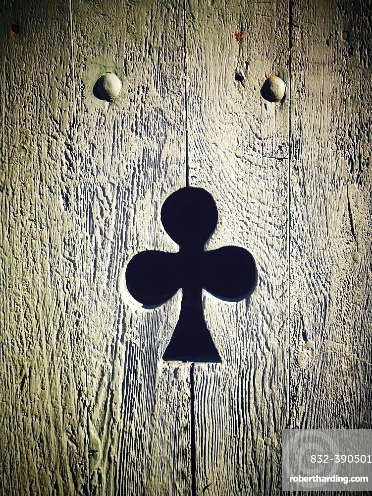 Clover shape cut out of wooden door