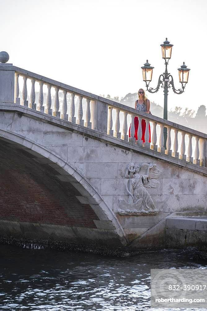 Young woman tourist walking over a bridge, Venice, Veneto, Italy, Europe