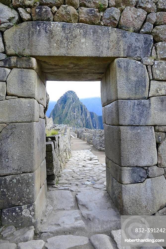Gate in the ruined city of the Incas at dawn with Mount Huayna Picchu, Machu Picchu, Urubamba Province, Peru, South America