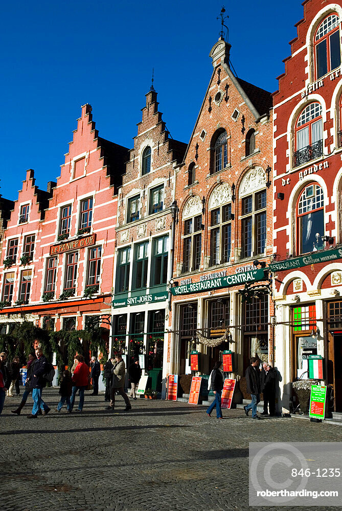 Gabled fronted restaurants in the Market Square at Christmas, Bruges, West Vlaanderen (Flanders), Belgium, Europe