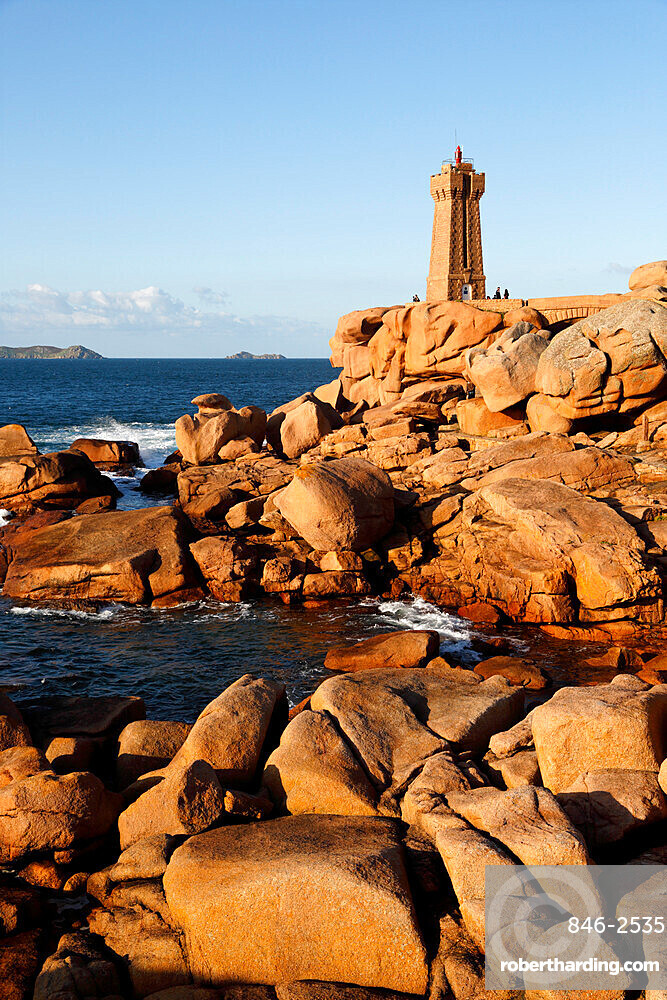 Lighthouse and pink rocks at sunset, Ploumanach, Cote de Granit Rose, Cotes d'Armor, Brittany, France, Europe