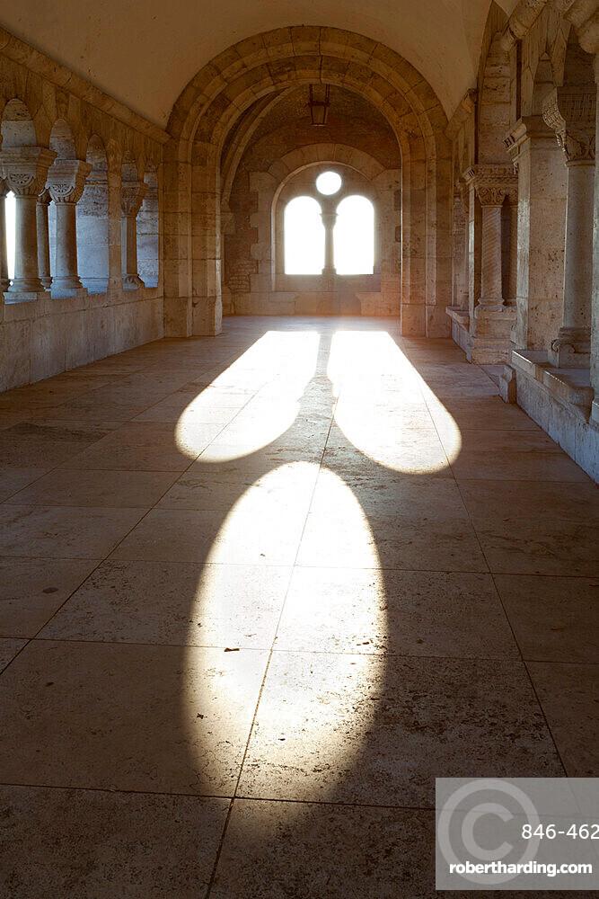 Sunlight pouring through arched windows, Fishermen's Bastion (Halaszbastya), Buda, Budapest, Hungary, Europe