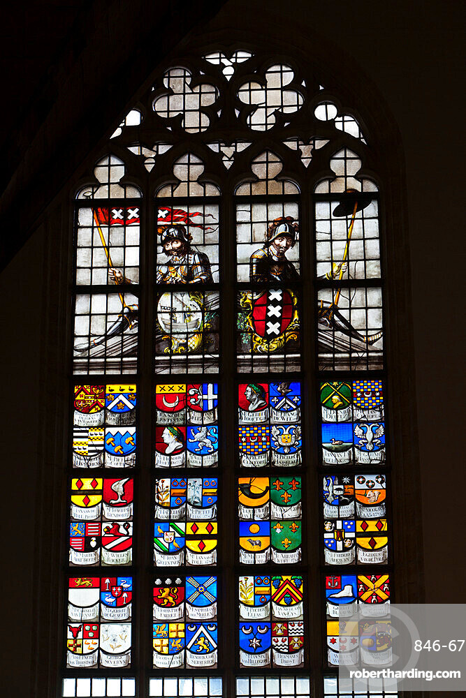 Oude Kerk (Old Church) stained glass windows showing Coats of Arms, Amsterdam, North Holland, Netherlands, Europe