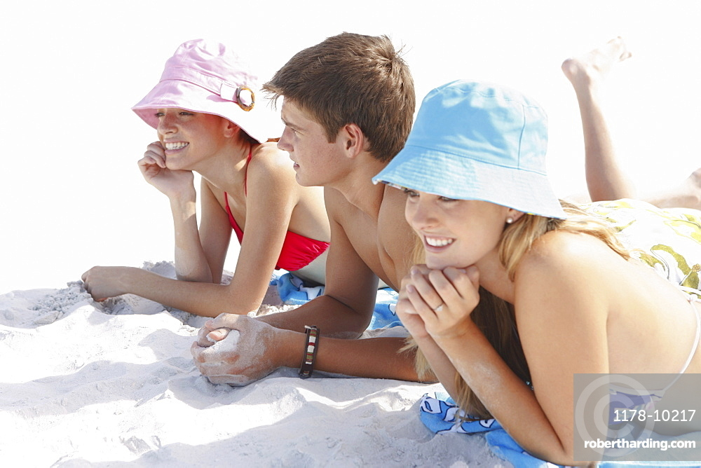 Friends sunbathing on beach