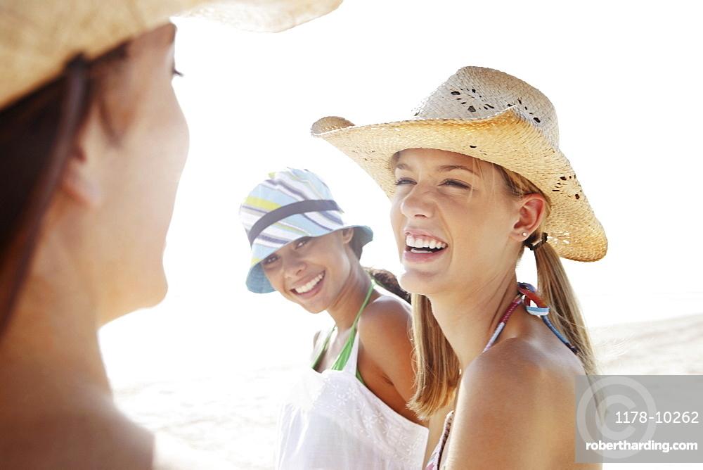 Friends laughing in beach