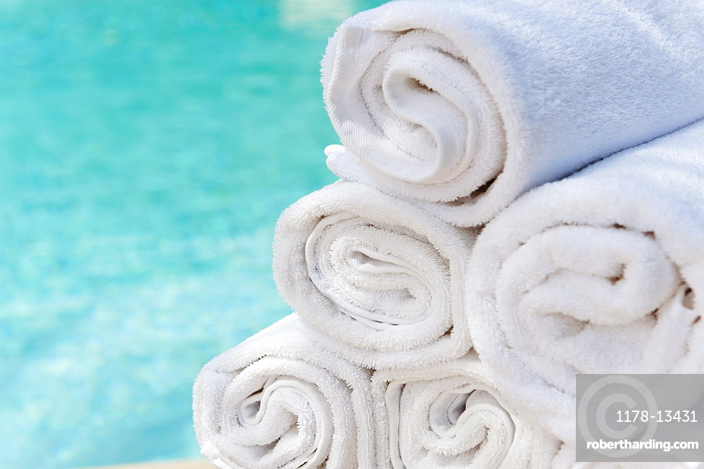 Rolled up towels in front of water