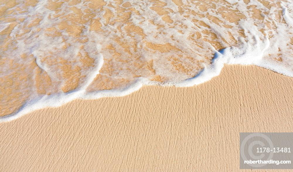 Sea waves on beach sand