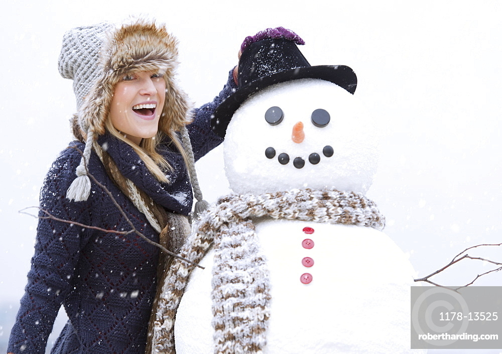 Portrait of woman with snowman