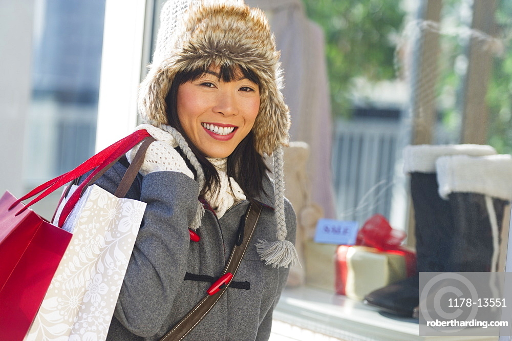 Smiling woman during Christmas shopping