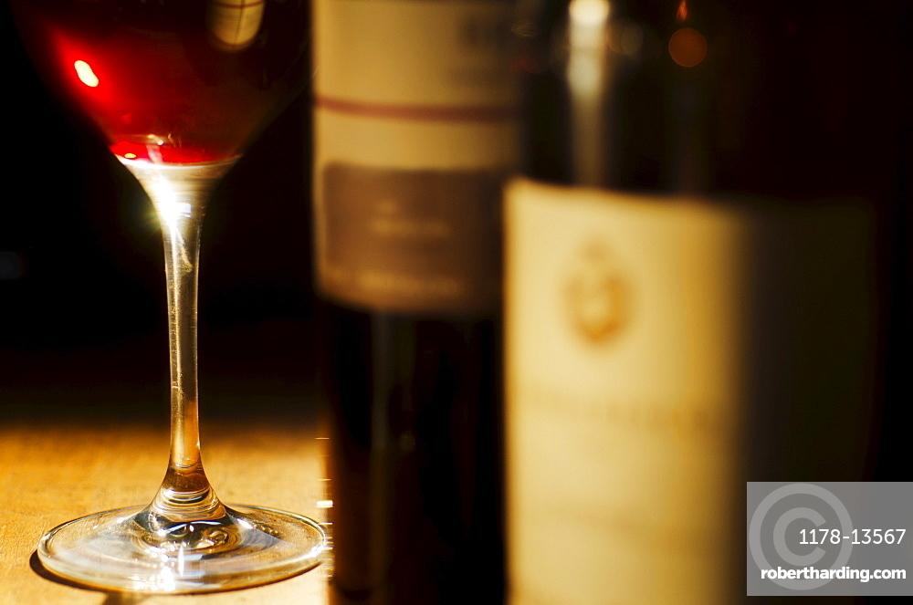 Studio shot of wine glass and bottles