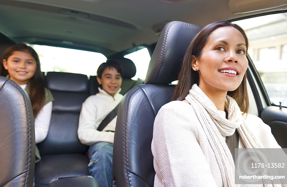 Mother with son (12-13) and daughter (10-11) in car