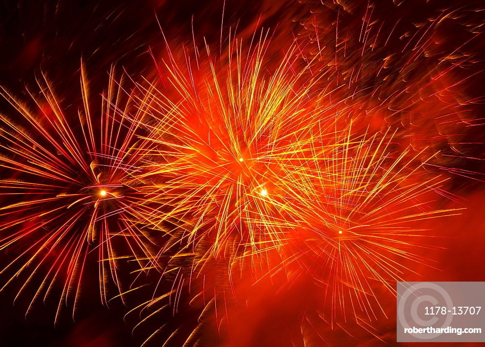 Fireworks explosion against night sky
