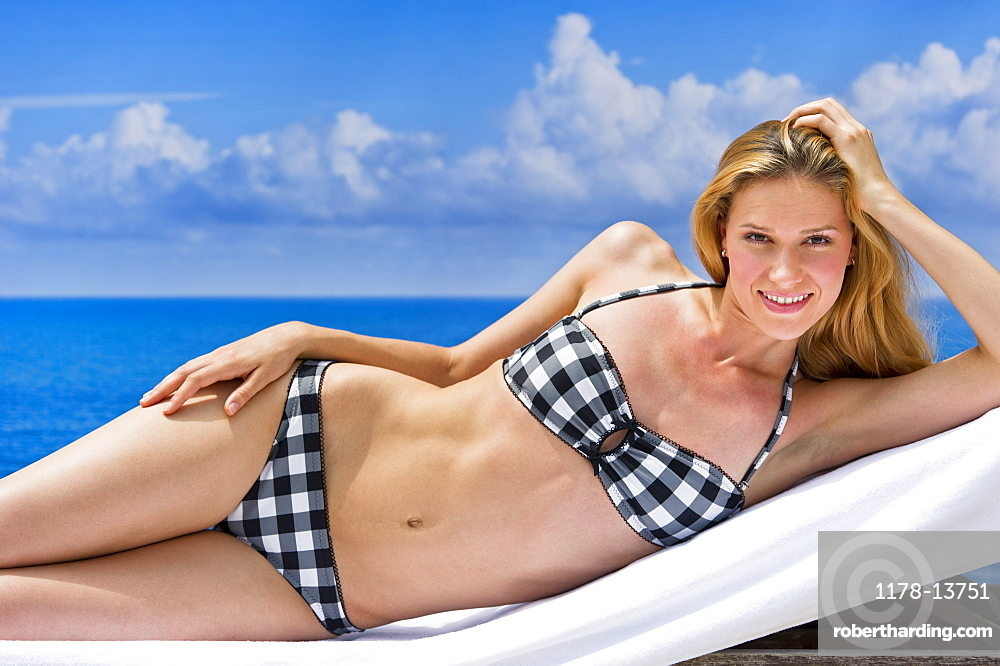 Portrait of woman on sunlounger