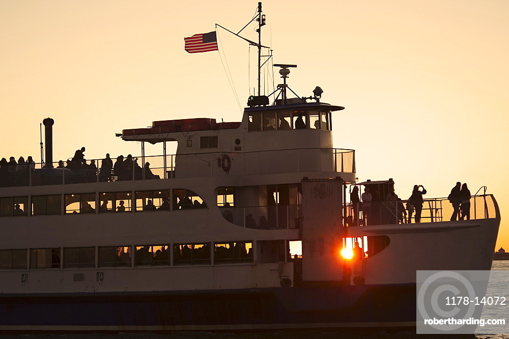 USA, New York City, Silhouette of passengers on tourboat