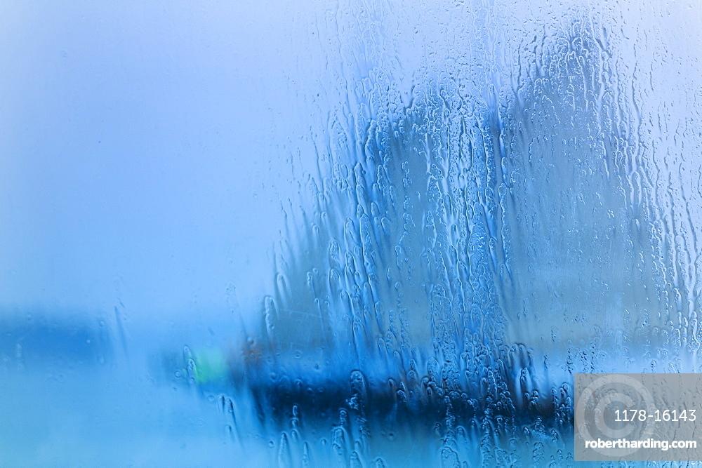 Schooner seen through wet window, Portland, Maine