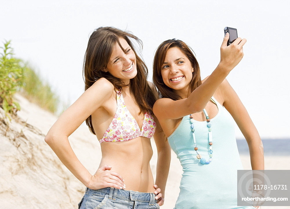 Young women taking own photograph
