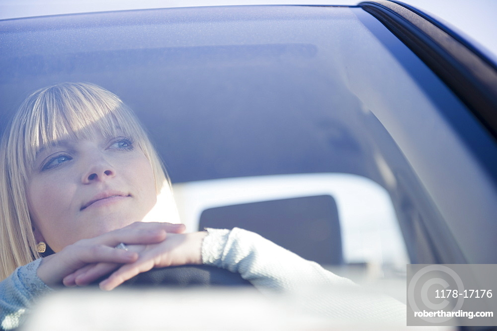 USA, Brooklyn, Williamsburg, Portrait of blonde woman driving car