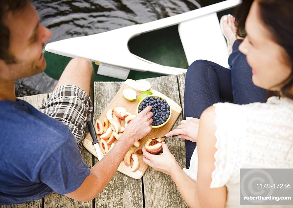 Roaring Brook Lake, Couple eating fruits on pier