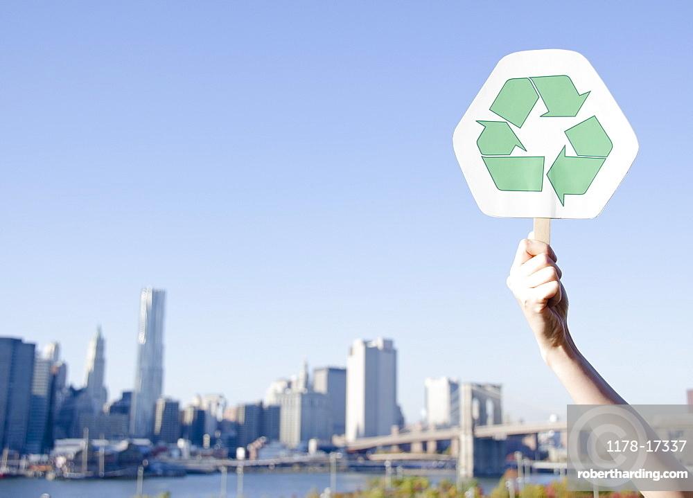 USA, New York State, New York City, Manhattan, Hand holding recycling symbol
