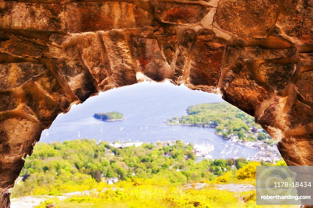 USA, Maine, Camden townscape as seen through stone arch, USA, Maine, Camden