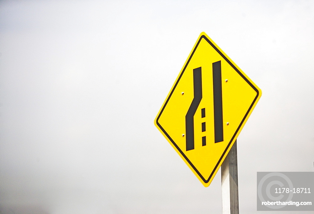 Lane ending street sign