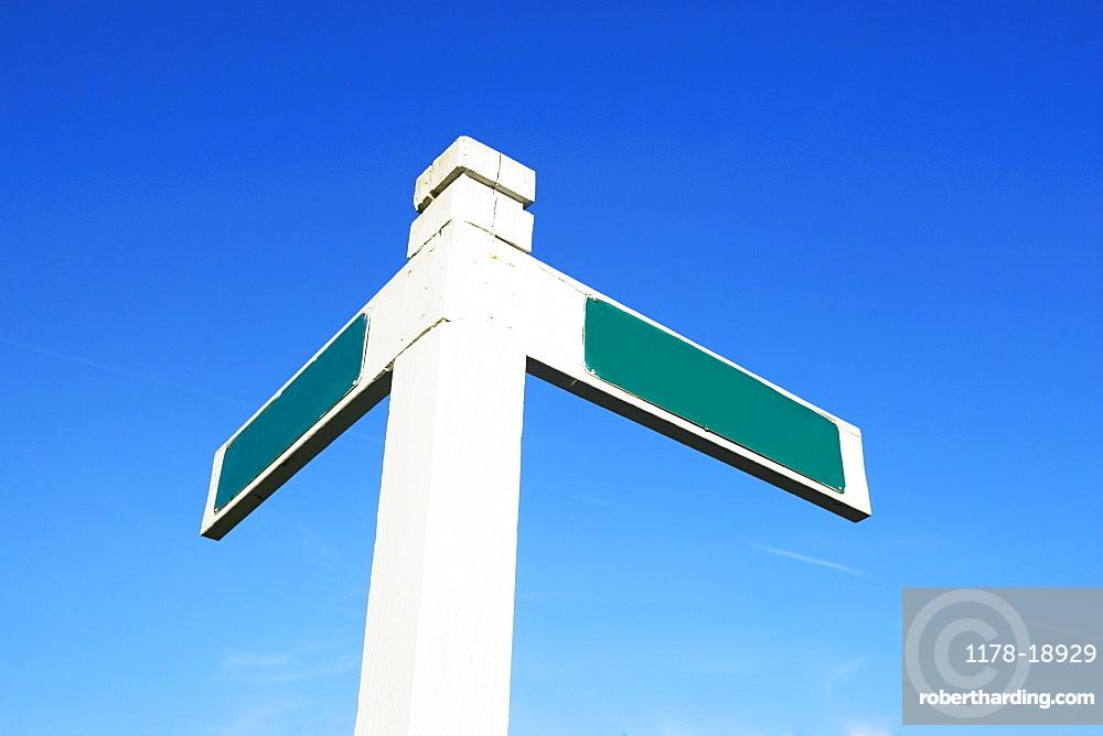 Blank street sign under blue sky