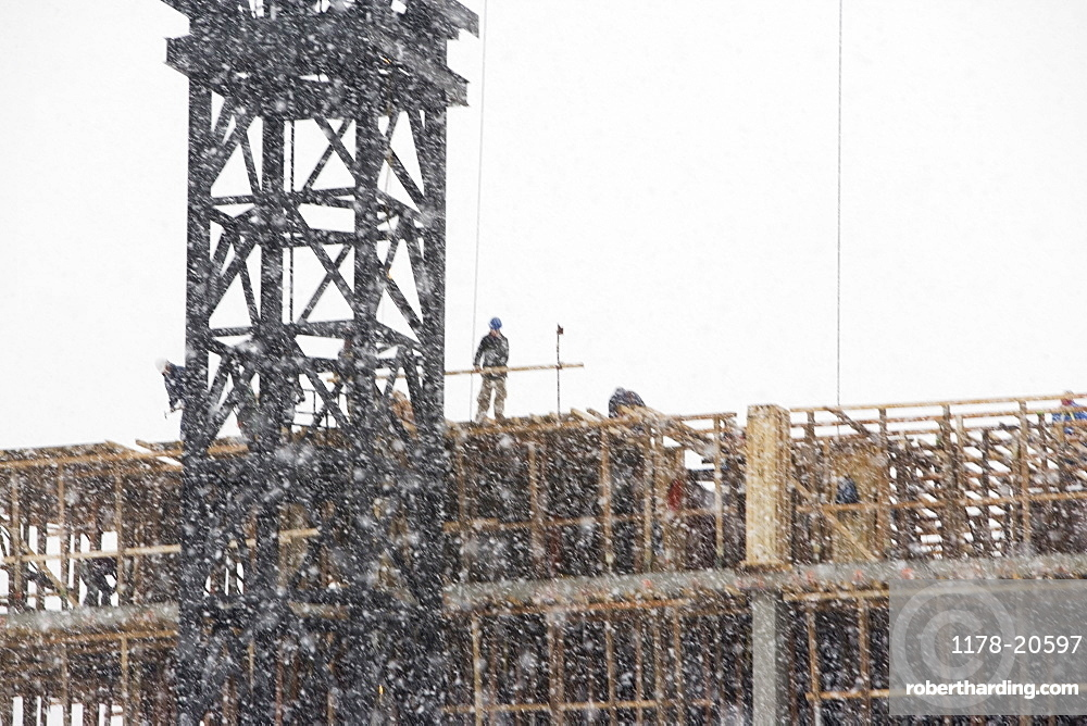 USA, New York City, construction site in snowstorm