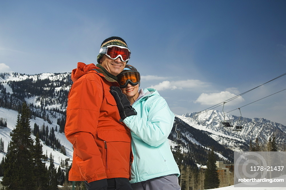 Couple in ski gear hugging