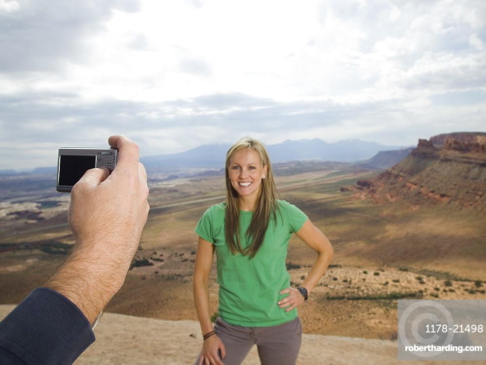 Woman having photograph taken