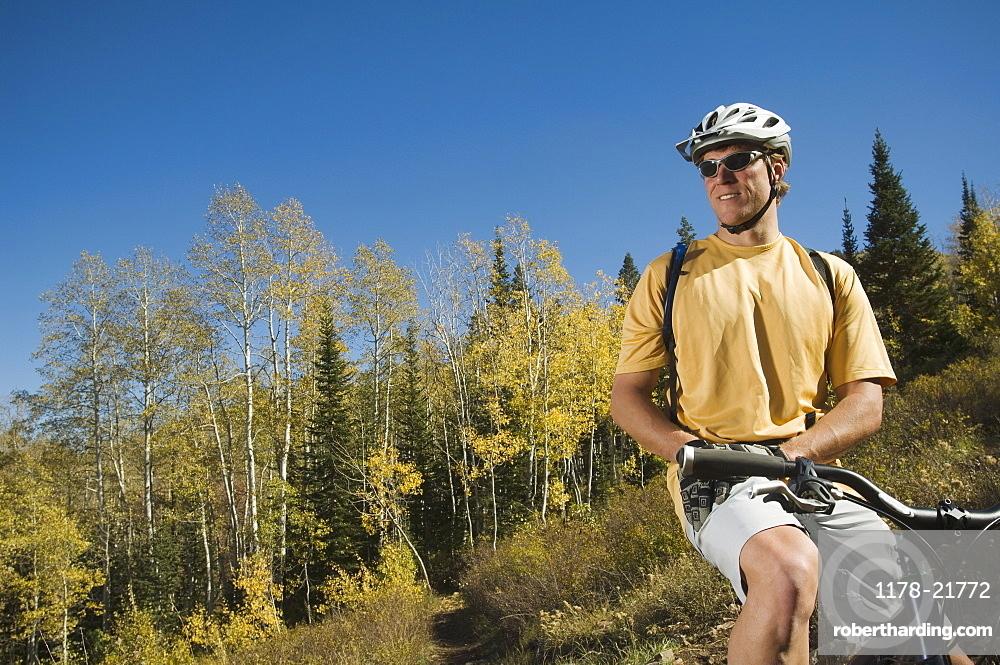 Man sitting on mountain bike, Utah, United States
