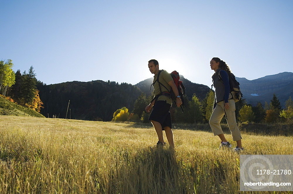 Couple hiking with backpacks, Utah, United States