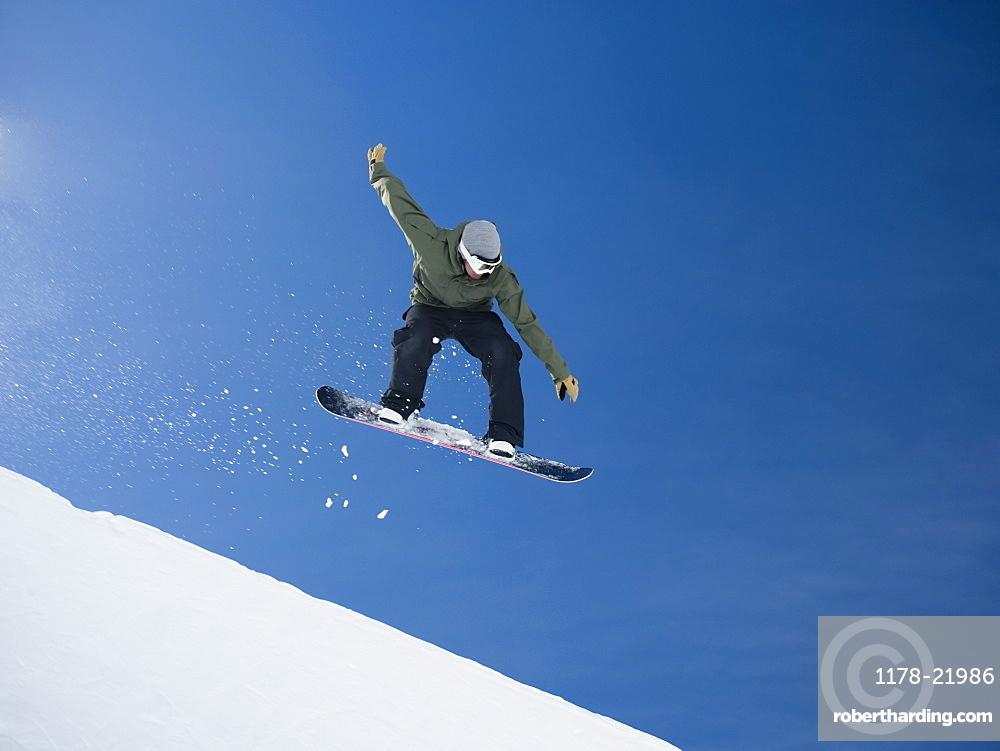 Man on snowboard in air