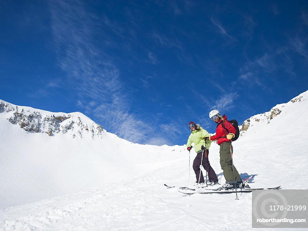 Women standing on skis