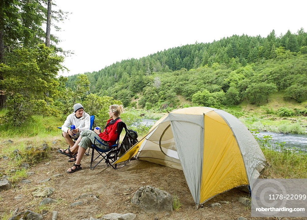 Couple relaxing at campsite