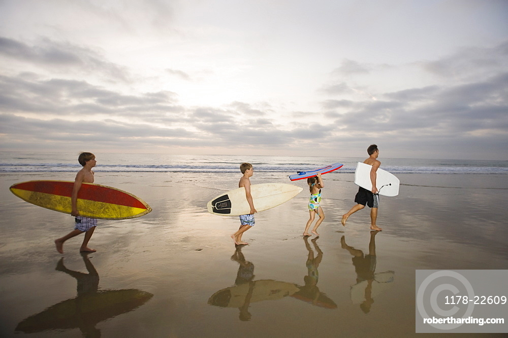 Family carrying surfboards