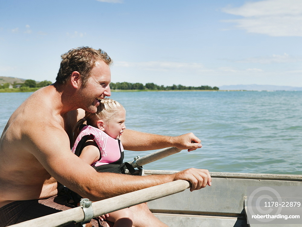 Father and daughter (2-3) on boat