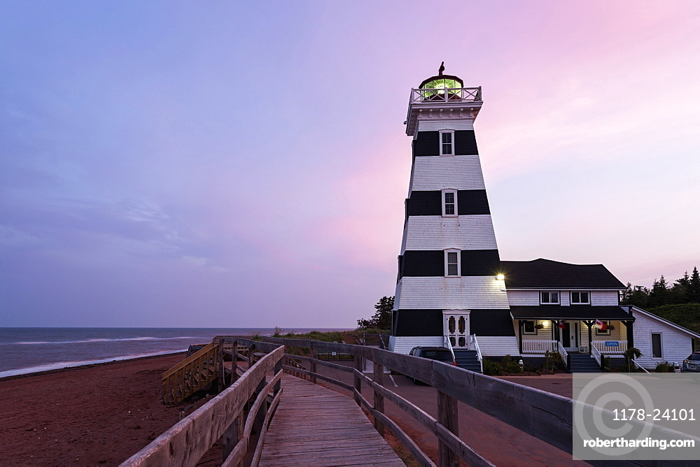 West Point Lighthouse and sandy beach at dusk, Prince Edward Island, New Brunswick, Canada