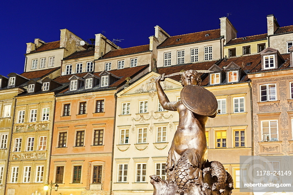 Mermaid of Warsaw against buildings, Poland