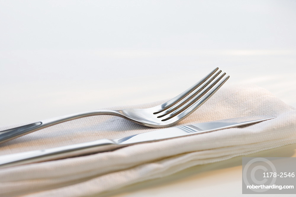 Close up of silverware on napkin