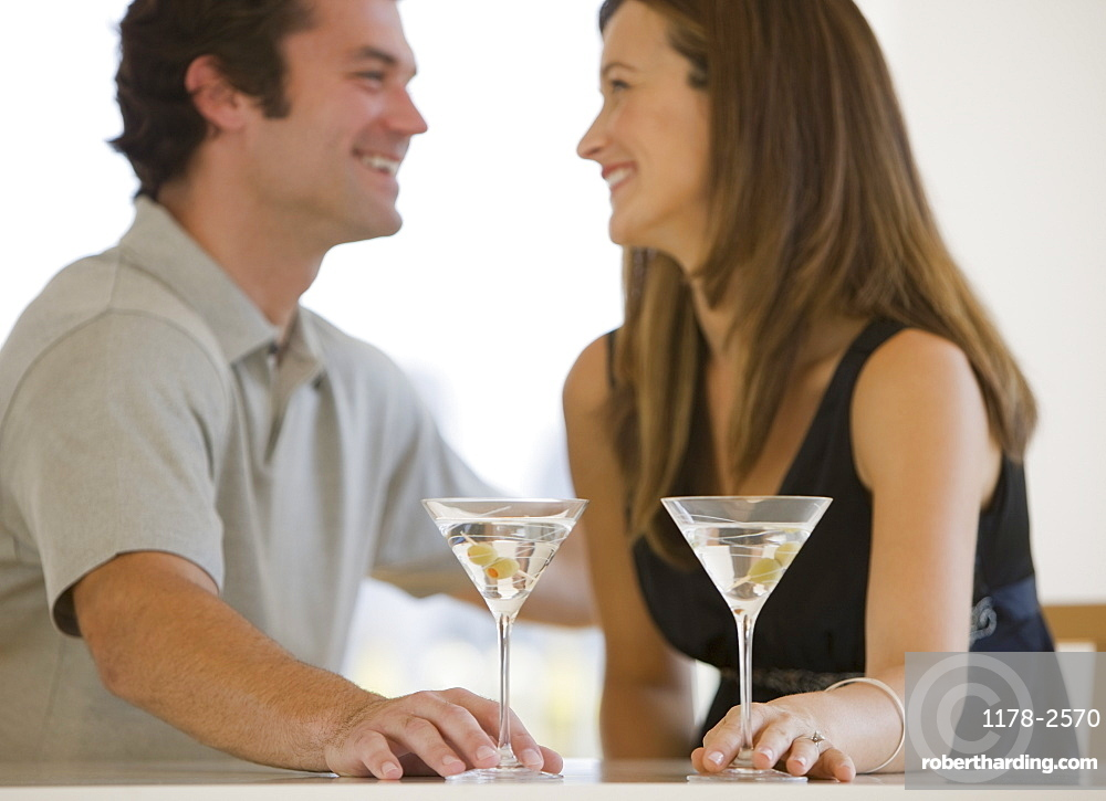 Couple drinking martinis