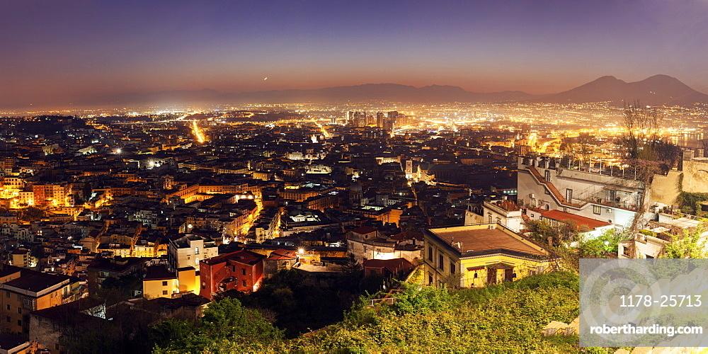 Italy, Campania, Naples, Panorama of city at sunrise
